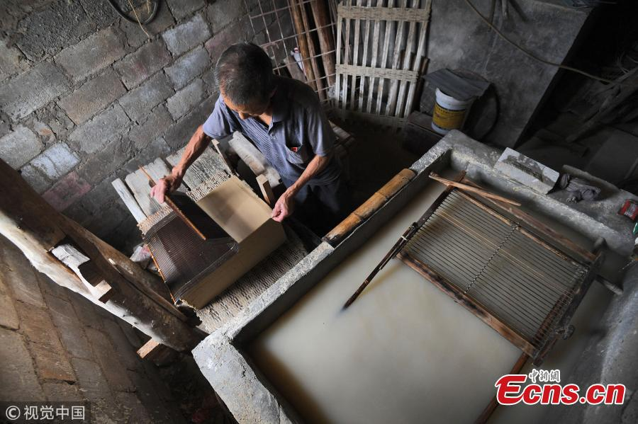 Huang Shiguo, 65, makes paper using ancient methods in his home in Baishui Village, Qiandongnan Miao and Dong Autonomous Prefecture, Southwest China's Guizhou Province. Huang said he began learning the traditional paper-making craft at 29 and has been dedicated to the ancient craft ever since. Locals in the area have a more than 1,000-year history of paper making as the region is rich in Yangshan Bamboo, a main material needed for the craft. Huang said the typical process involves 72 steps and 55 days to produce paper. (Photo/VCG)