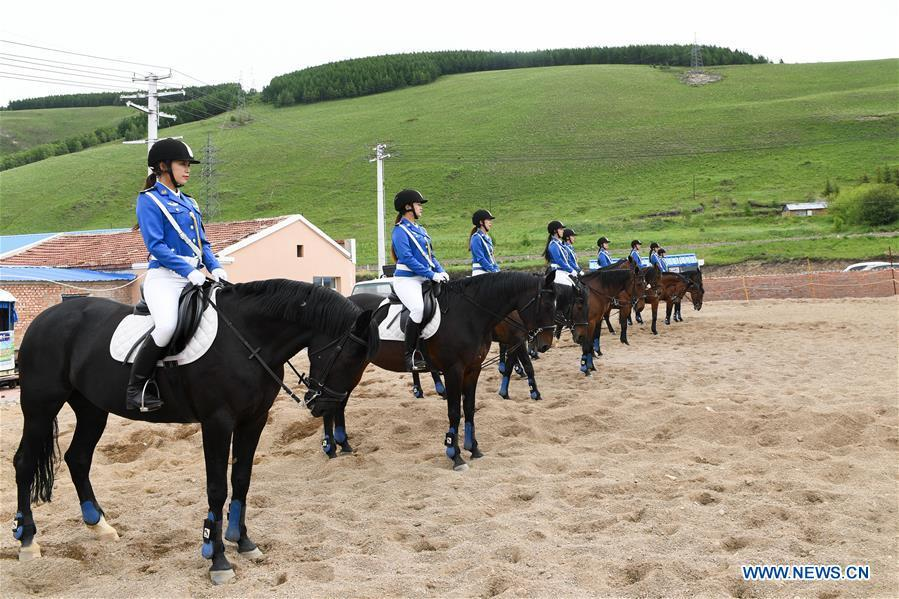 Members of a female mounted patrol unit gather on a training ground in Arxan, north China\'s Inner Mongolia Autonomous Region, June 24, 2018. Every year, the female mounted patrol unit of Arxan will patrol the city between June and October, the high season for tourism. Apart from regular patrols, the members are also expected to perform ceremonial tasks on formal occasions. (Xinhua/Liu Lei)