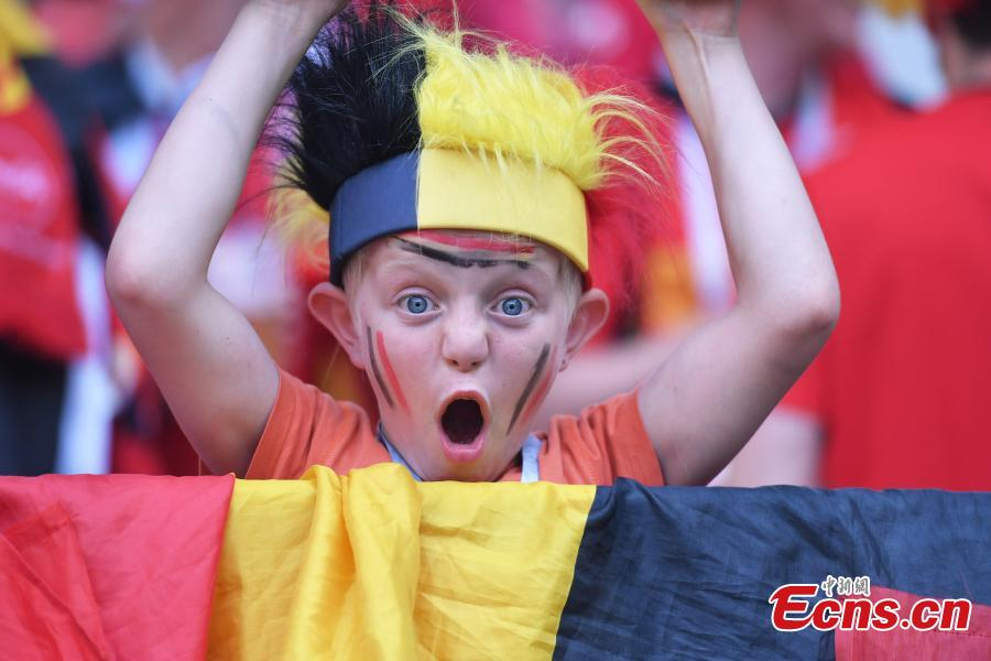 A Belgian fan celebrates during a World Cup match between Belgium and Tunisia in Spartak Stadium, Moscow, Russia, June 23, 2018. (Photo: China News Service/Tian Bochuan)