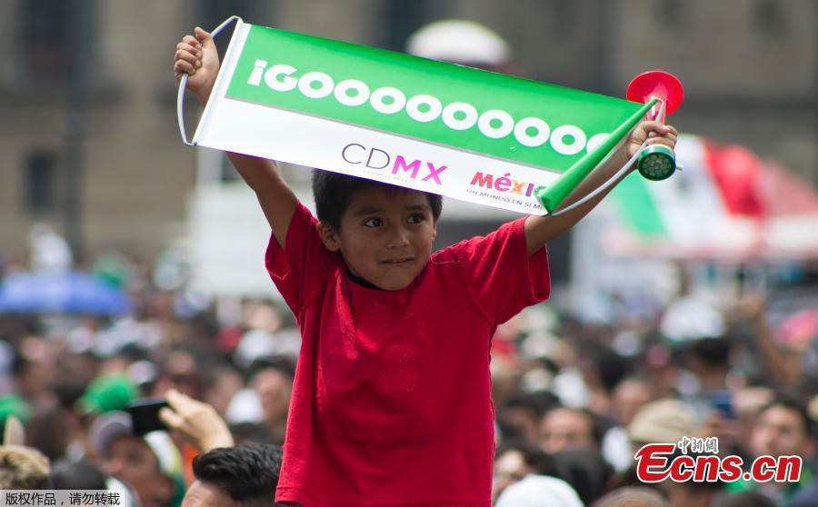 A Mexican boy reacts as he watches the World Cup match between Mexico and South Korea in Mexico City, June 23, 2018. (Photo/Agencies)