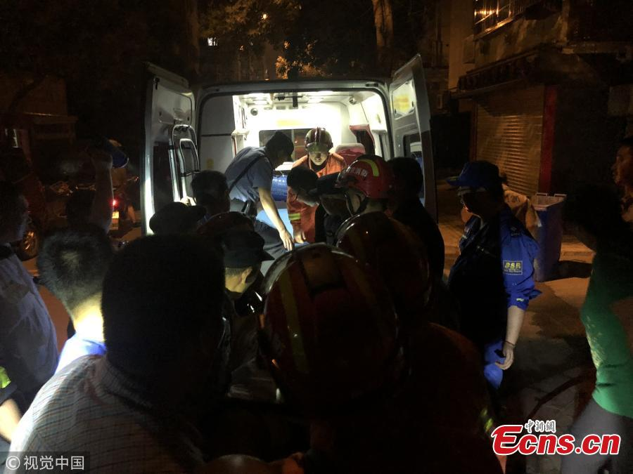 An overweight man is helped to move out of his family home on the third floor of a building in Nanjing, East China's Jiangsu Province. The man, who has weighed as much as 175 kilograms at a previous weigh-in, has stayed in his home for two years without going out, according to his father. He was injured in a fall. It took professional rescuers three hours to assist medical staff and transfer him to a hospital. (Photo/VCG)