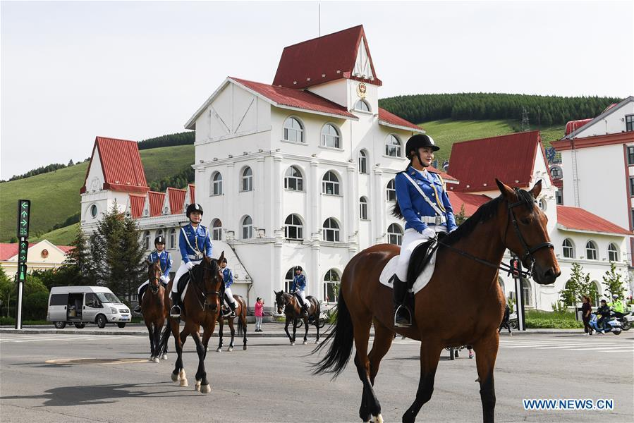 Members of a female mounted patrol unit are seen on duty in Arxan, north China\'s Inner Mongolia Autonomous Region, June 24, 2018. Every year, the female mounted patrol unit of Arxan will patrol the city between June and October, the high season for tourism. Apart from regular patrols, the members are also expected to perform ceremonial tasks on formal occasions. (Xinhua/Liu Lei)