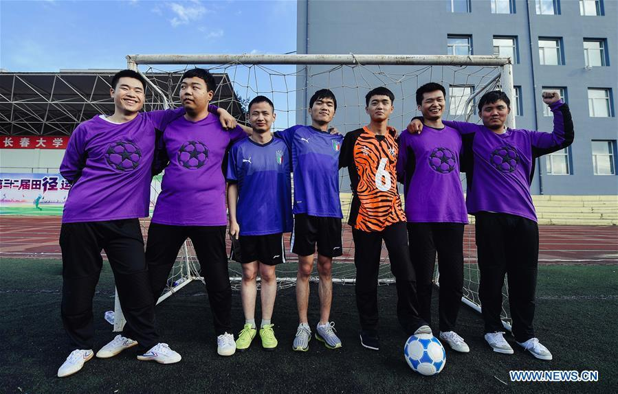 Some football players of the special education school of Changchun University pose for a group photo in Changchun, northeast China\'s Jilin Province, June 20, 2018. Sun Dongyuan and Fan Changjie, who were diagnosed with congenital eye disease, learn acupuncture and massage in the school. They are also players of the school\'s football team for visually impaired students. During the match, Sun and Fan identify position via a bell inside the ball and with guides\' instructions. The FIFA World Cup 2018 has become their popular topic since June 14, and they listen to the live broadcast and cheer for their favorite teams. (Xinhua/Xu Chang)
