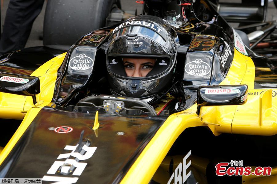 "Aseel Al-Hamad of Saudi Arabia drives a Lotus Renault E20 Formula One car during a parade before the French Grand Prix in Circuit Paul Ricard, Le Castellet, France, June 24, 2018. Aseel Al-Hamad drove in front of thousands of fans on Sunday and declared the start of a new era for Saudi women in motorsport. ""I believe today is not just celebrating the new era of women starting to drive, it's also the birth of women in motorsport in Saudi Arabia,"" she said. (Photo/Agencies)"