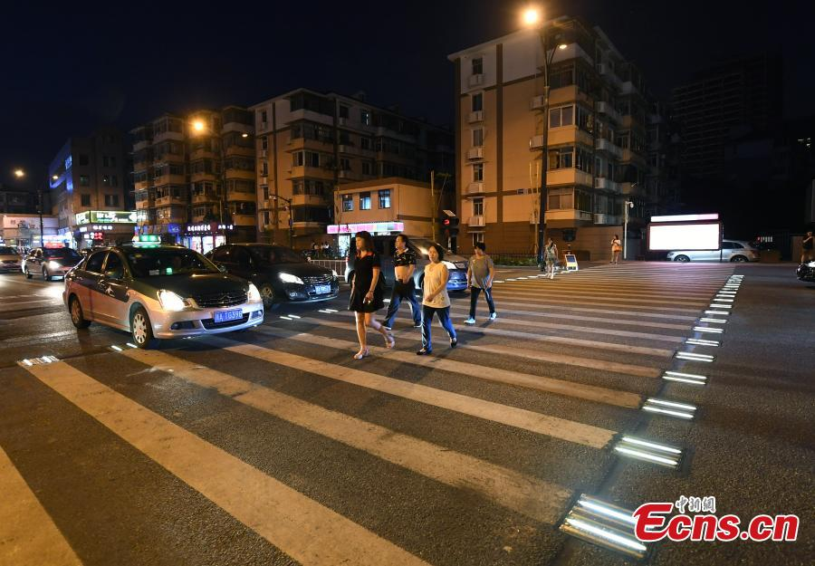 Lights on two sides of a zebra crossing on a street in Zhejiang Province will automatically light up when they sense pedestrians, reminding cars to slow down.