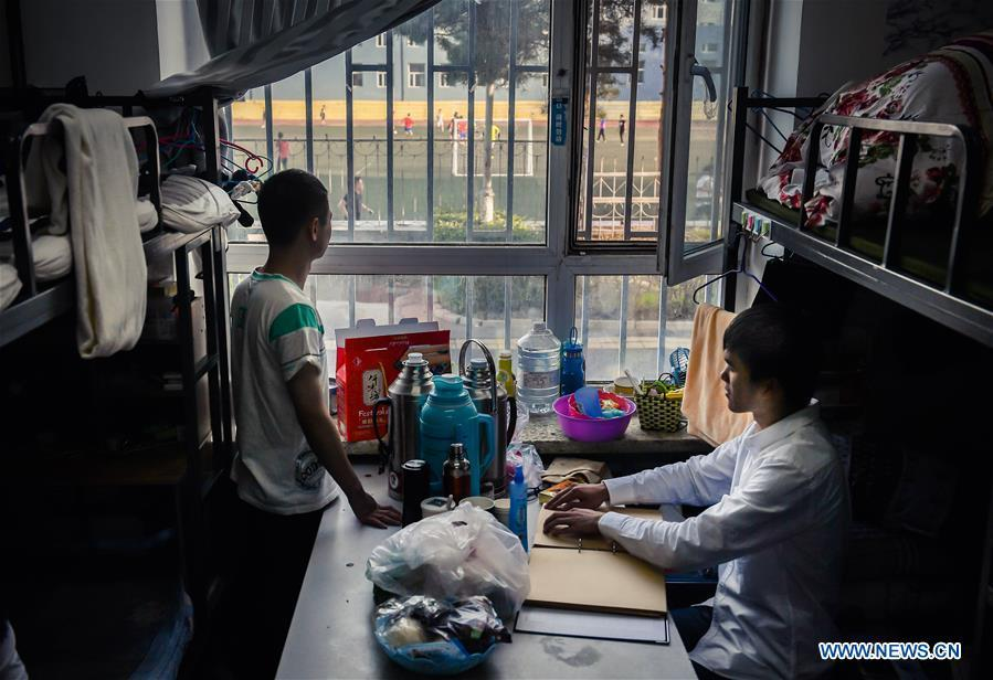 Sun Dongyuan (R) and Fan Changjie are seen in their dormitory at the special education school of Changchun University in northeast China\'s Jilin Province, June 20, 2018. Sun Dongyuan and Fan Changjie, who were diagnosed with congenital eye disease, learn acupuncture and massage in the school. They are also players of the school\'s football team for visually impaired students. During the match, Sun and Fan identify position via a bell inside the ball and with guides\' instructions. The FIFA World Cup 2018 has become their popular topic since June 14, and they listen to the live broadcast and cheer for their favorite teams. (Xinhua/Xu Chang)