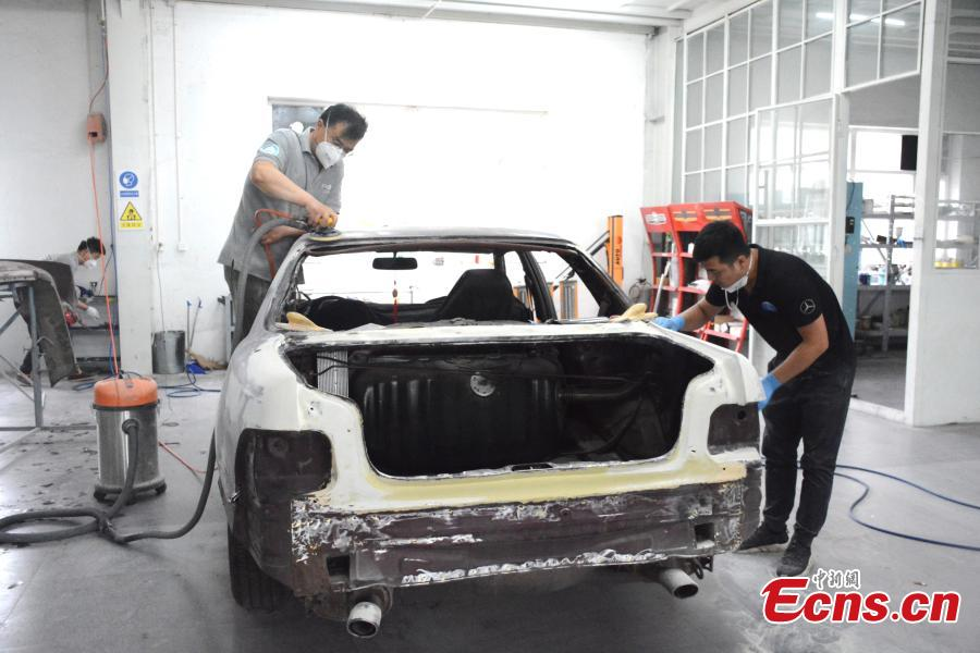A classic car is repaired at Dalian Jingdian Auto Culture Center in Dalian City, Liaoning Province, June 26, 2018. The center has hundreds of classic cars under maintenance, including a car donated by Stalin to Mao Zedong and a 1932 Rolls-Royce 20/25 car. Center founder Han Yeguang said all the classic cars were either from foreign museums or private collectors, and the time taken to restore each vehicle ranged from six months to four years. (Photo: China News Service/Yang Yi)