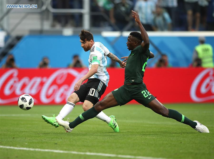 Lionel Messi (L) of Argentina shoots to score during the 2018 FIFA World Cup Group D match between Nigeria and Argentina in Saint Petersburg, Russia, June 26, 2018. (Xinhua/Wu Zhuang)