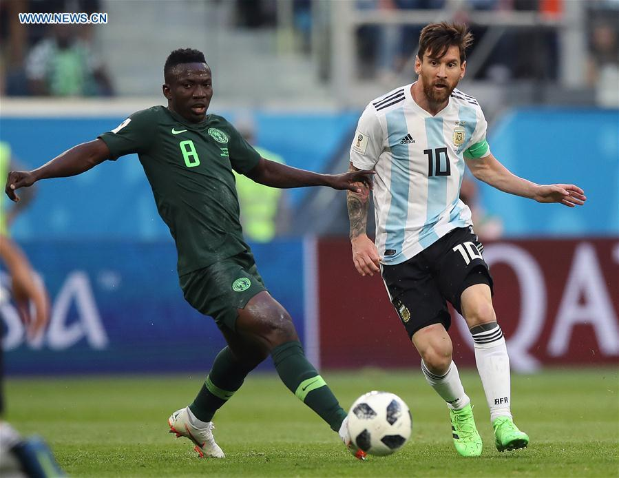 Lionel Messi (R) of Argentina vies with Oghenekaro Etebo of Nigeria during the 2018 FIFA World Cup Group D match between Nigeria and Argentina in Saint Petersburg, Russia, June 26, 2018. (Xinhua/Wu Zhuang)