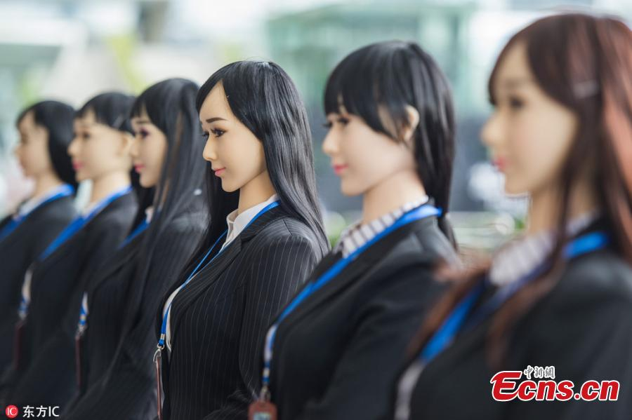 Humanoid robots are used to promote public awareness of drug abuse in an event to mark the International Day Against Drug Abuse and Illicit Trafficking at a railway station in Shenzhen City, South China\'s Guangdong Province, June 26, 2018. The six robots distributed brochures and interacted with visitors at the event, jointly organized by local police, an artificial intelligence association and a robot developer. (Photo/IC)