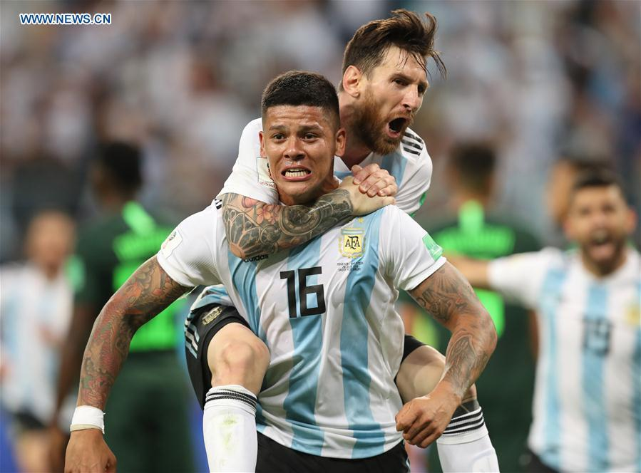 Argentina\'s Marcos Rojo (bottom) celebrates scoring with Lionel Messi during the 2018 FIFA World Cup Group D match between Nigeria and Argentina in Saint Petersburg, Russia, June 26, 2018. Argentina won 2-1 and advanced to the round of 16. (Xinhua/Yang Lei)