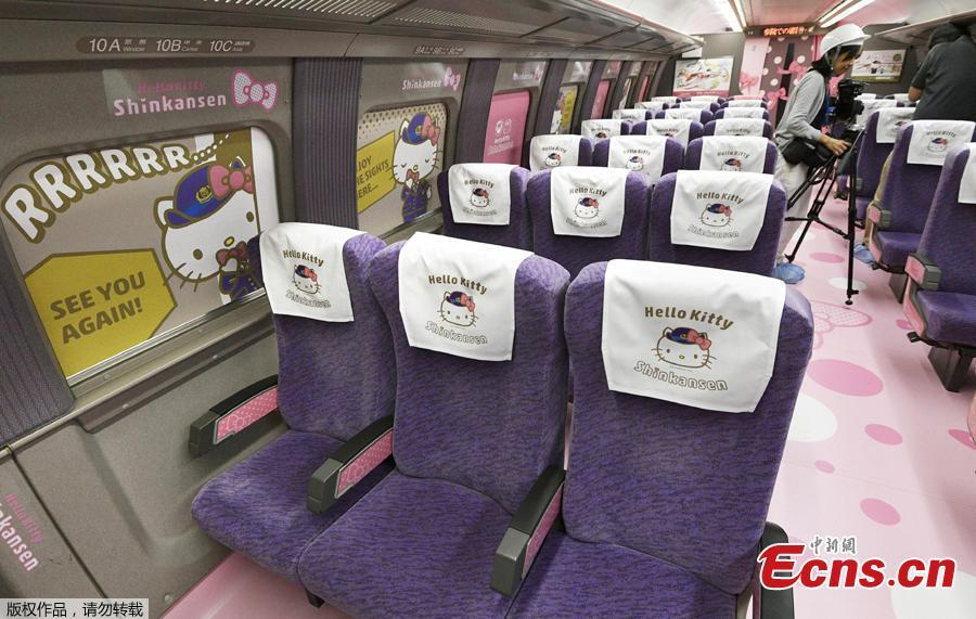 West Japan Railway Company unveils Hello Kitty Shinkansen, bullet train, at Hakata Railyard and Factory in Nakagawa-machi, Fukuoka Prefecture on June 25, 2018. It will travel between Shin-Osaka and Hakata station from June 30. Various kinds of Tourist Information will be offered at the first car and visitors can take picture with Kitty at the second.( Photo/Agencies)