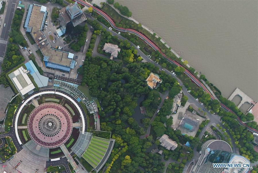 Aerial photo taken on May 14, 2017 shows a riverside path of the Lujiazui area in Pudong of Shanghai, east China. China announced the opening-up and development of Pudong in 1990. Pudong is expecting to take the opportunity of celebrating the 40th anniversary of China\'s reform and opening-up to continue to spearhead the country\'s reform and development. (Xinhua/Ding Ting)