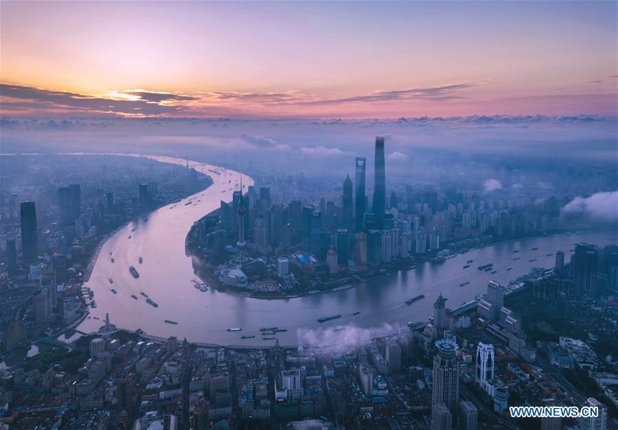 Aerial photo taken on June 21, 2018 shows morning view of the Lujiazui area in Pudong of Shanghai, east China. China announced the opening-up and development of Pudong in 1990. Pudong is expecting to take the opportunity of celebrating the 40th anniversary of China\'s reform and opening-up to continue to spearhead the country\'s reform and development. (Xinhua/Ren Long)