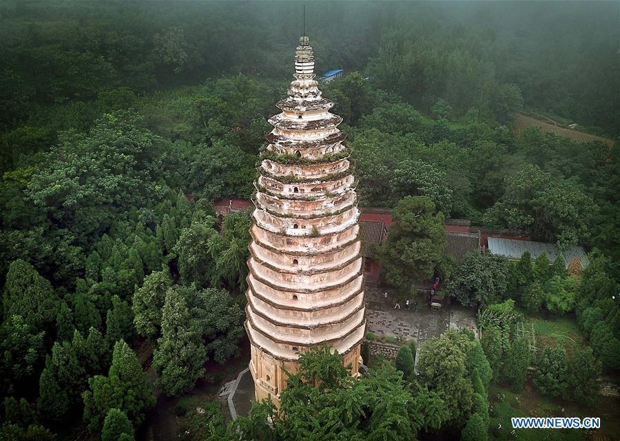 Photo taken on June 26, 2018 shows the Pagoda of the Songyue Temple in Dengfeng City, central China\'s Henan Province. The pagoda was built in the Northern Wei Dynasty (369-534). Pagodas built in ancient times in Henan act not only as landmarks for sight-seeing, but also as observers of the Chinese history. (Xinhua/Li An)