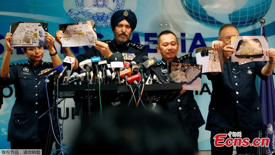 Amar Singh, head of Malaysia\'s Commercial Crime Investigation Department (CCID), and other police officers display photos of items from a raid on former Malaysian Prime Minister Najib Razak\'s premises during a news conference in Kuala Lumpur, Malaysia June 27, 2018. Malaysian police say the total value of cash, jewelry and hundreds of watches and handbags seized from properties linked to Najib in a money-laundering investigation amounted to $273 million. (Photo/Agencies)