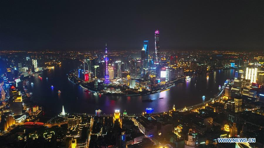Aerial photo taken on April 15, 2017 shows night view of the Huangpu River in Shanghai, east China. China announced the opening-up and development of Pudong in 1990. Pudong is expecting to take the opportunity of celebrating the 40th anniversary of China\'s reform and opening-up to continue to spearhead the country\'s reform and development. (Xinhua/Ding Ting)