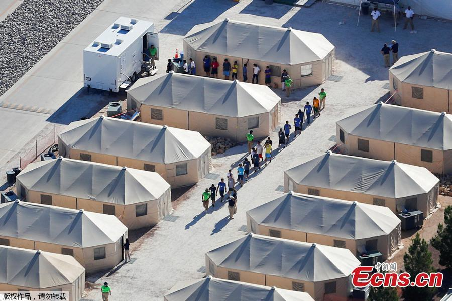 Photo taken June 18, 2018 shows immigrant children, many of whom have been separated from their parents under a new \