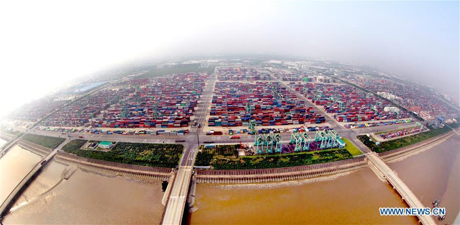 Aerial photo taken on Sept. 29, 2014 shows the Waigaoqiao container pier of Shanghai free trade zone (FTZ) in Pudong of Shanghai, east China. China announced the opening-up and development of Pudong in 1990. Pudong is expecting to take the opportunity of celebrating the 40th anniversary of China\'s reform and opening-up to continue to spearhead the country\'s reform and development. (Xinhua/Fan Jun)
