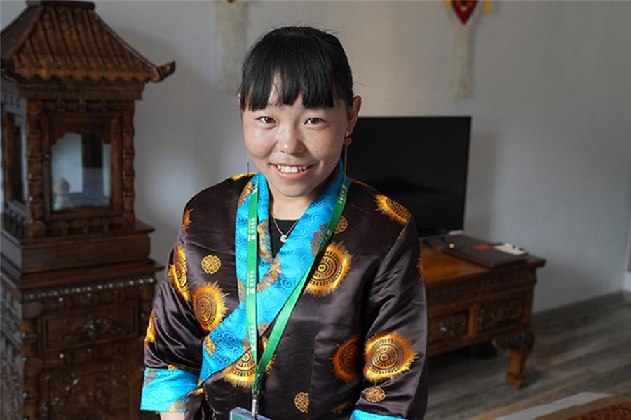 A homestay operator at Boma village in Lhasa, Tibet autonomous region, June 22, 2018. (Photo/Xinhua)