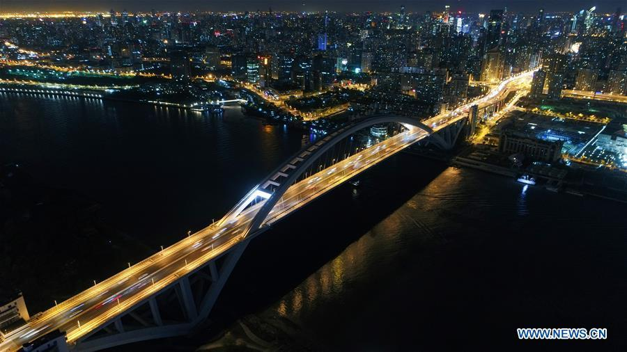 Aerial photo taken on April 13, 2017 shows the Lupu Bridge in Shanghai, east China. China announced the opening-up and development of Pudong in 1990. Pudong is expecting to take the opportunity of celebrating the 40th anniversary of China\'s reform and opening-up to continue to spearhead the country\'s reform and development. (Xinhua/Ding Ting)