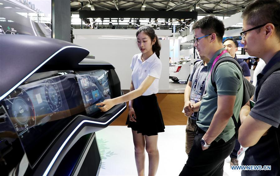 Visitors look at an interactive car dashboard that uses wireless network technologies during the Mobile World Conference Shanghai (MWCS) 2018 in east China\'s Shanghai, June 27, 2018. The three-day MWCS 2018 kicked off at the Shanghai New International Expo Center on Wednesday, showing trending mobile products, services and technologies. (Xinhua/Fang Zhe)