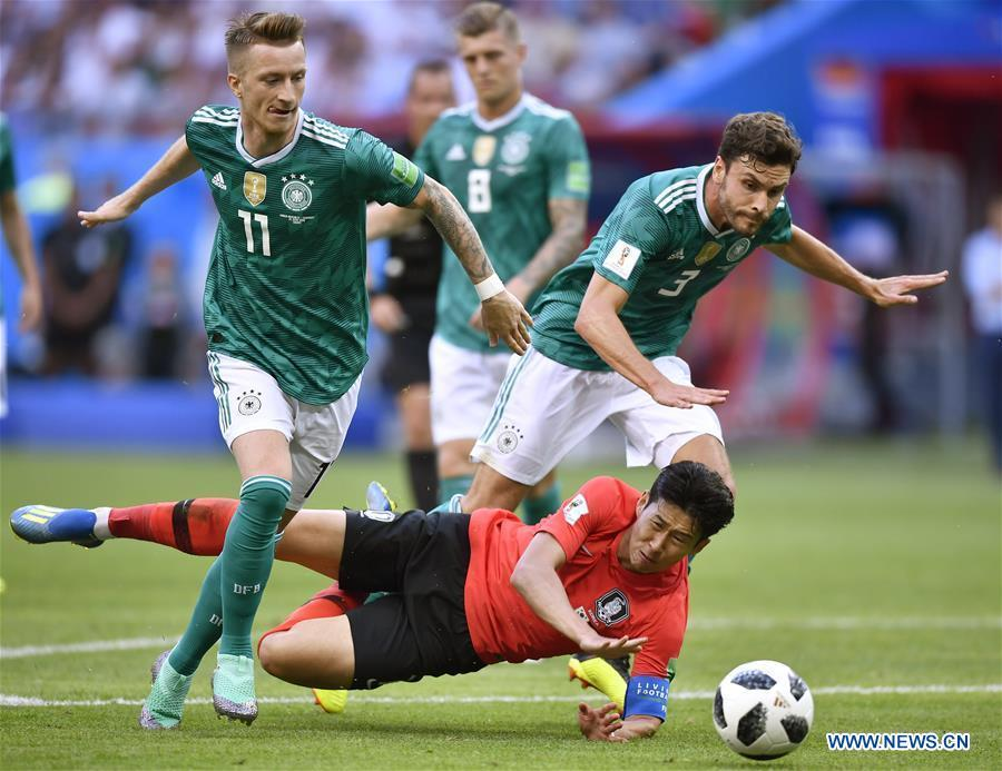 Son Heungmin (bottom) of South Korea falls down during the 2018 FIFA World Cup Group F match between Germany and South Korea in Kazan, Russia, June 27, 2018. (Xinhua/Chen Yichen)