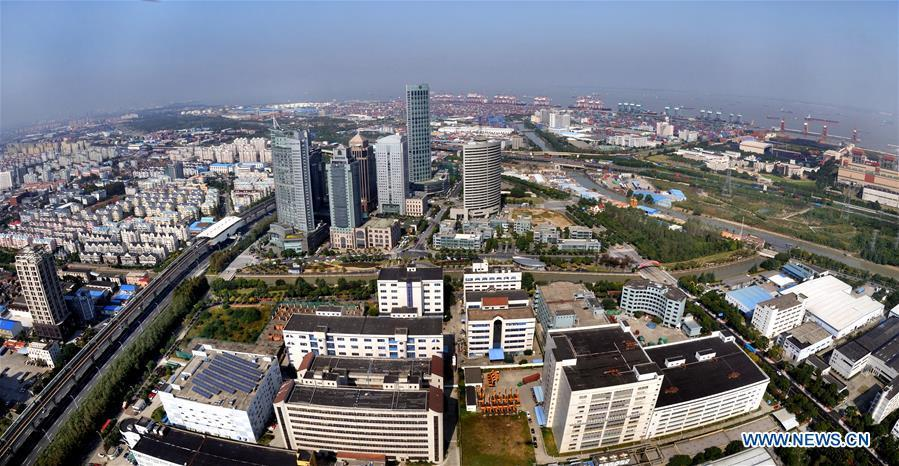 Aerial photo taken on Oct. 29, 2013 shows a scene of Waigaoqiao area in Shanghai free trade zone (FTZ) in Pudong of Shanghai, east China. China announced the opening-up and development of Pudong in 1990. Pudong is expecting to take the opportunity of celebrating the 40th anniversary of China\'s reform and opening-up to continue to spearhead the country\'s reform and development. (Xinhua/Fan Jun)