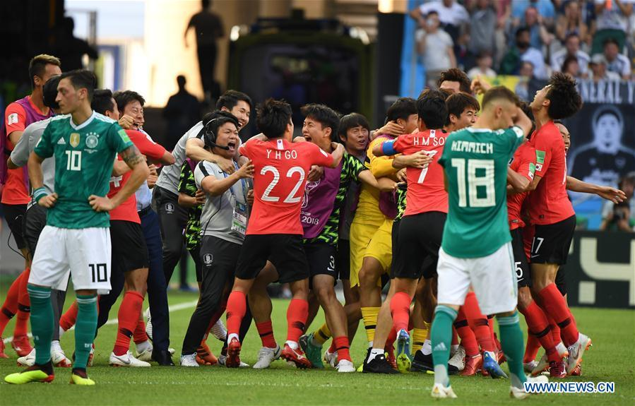 Players of South Korea celebrate after the referee confirmed a goal of South Korea valid after the Video Assistant Referee (VAR) review during the 2018 FIFA World Cup Group F match between Germany and South Korea in Kazan, Russia, June 27, 2018. South Korea won 2-0. (Xinhua/Li Ga)