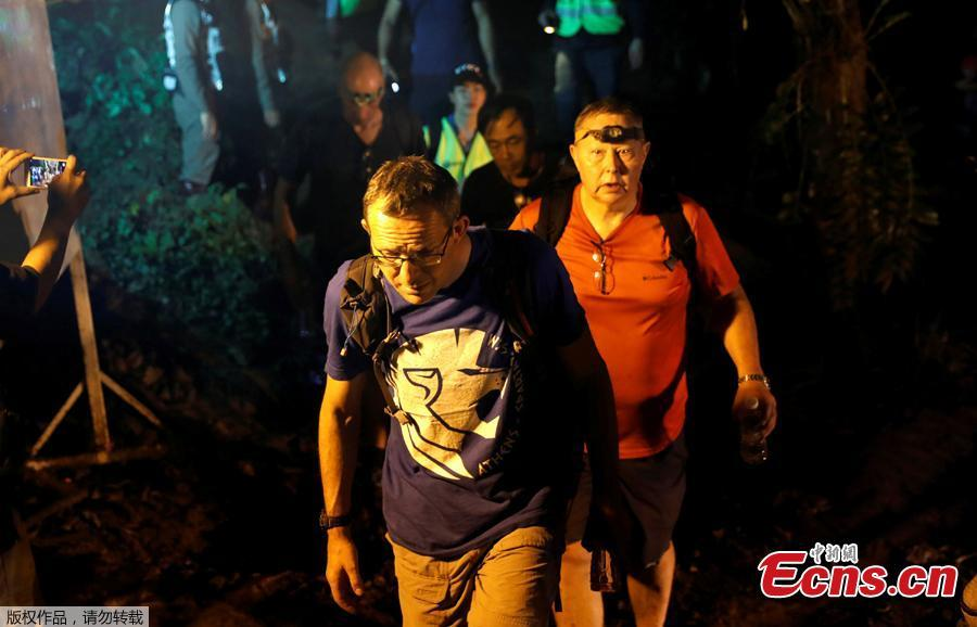 British divers John Volanthen and Robert Charles Harper leave after they checked the Tham Luang caves during a search for the members of an under-16 soccer team and their coach, in the northern province of Chiang Rai, Thailand, June 27, 2018.  (Photo/Agencies)