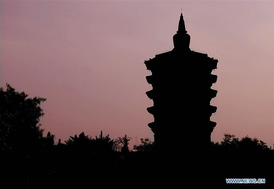 File photo taken on April 25, 2017 shows the the Pagoda of Tianning Temple in Anyang, central China\'s Henan Province. The pagoda has a history of over 1,000 years. Pagodas built in ancient times in Henan act not only as landmarks for sight-seeing, but also as observers of the Chinese history. (Xinhua/Li An)