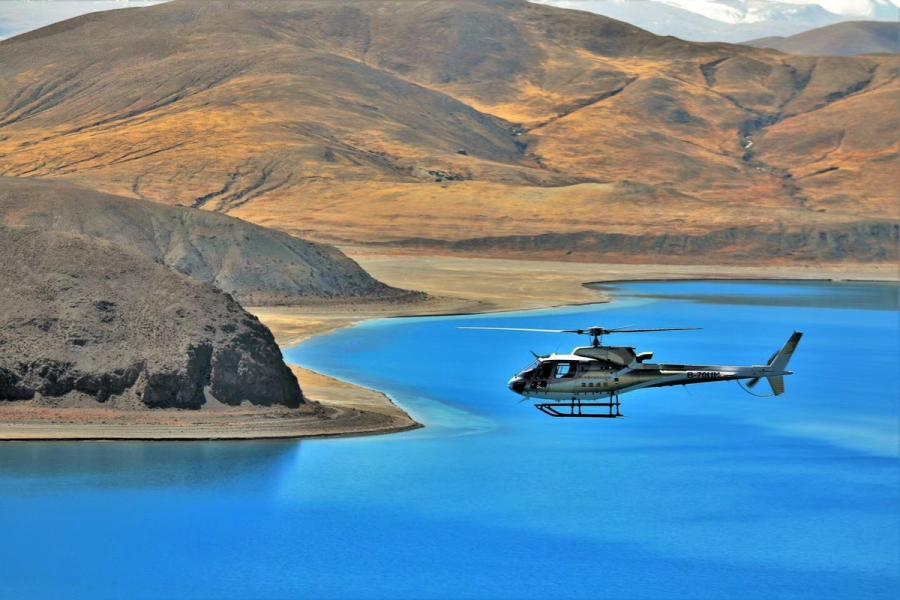 A helicopter flies over the Nam Co Lake, Tibet autonomous region. (Photo provided to chinadaily.com.cn)
