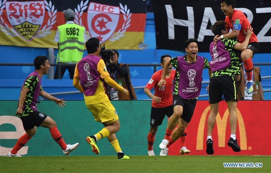 Players of South Korea celebrate scoring during the 2018 FIFA World Cup Group F match between Germany and South Korea in Kazan, Russia, June 27, 2018. South Korea won 2-0. (Xinhua/Li Ga)