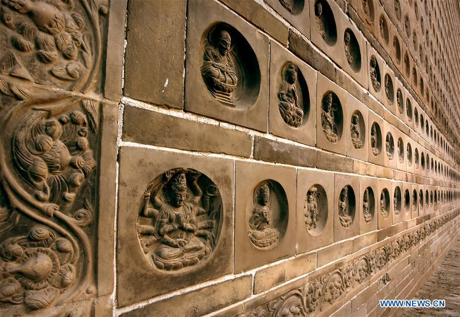 File photo taken on Oct. 17, 2015 shows brick carving on the Fanta Pagoda in Kaifeng, central China\'s Henan Province. The pagoda was built in 974 A.D. Pagodas built in ancient times in Henan act not only as landmarks for sight-seeing, but also as observers of the Chinese history. (Xinhua/Li An)