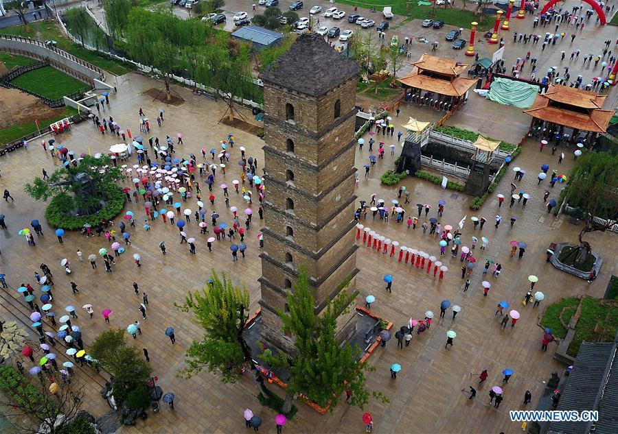 File photo taken on April 10, 2017 shows the Wenfeng Pagoda in Luoyang, central China\'s Henan Province. The pagoda, first built in the Song Dynasty (960-1127) and destroyed at the end of the Ming Dynasty (1368-1644), was reconstructed in the Qing Dynasty (1644-1911). Pagodas built in ancient times in Henan act not only as landmarks for sight-seeing, but also as observers of the Chinese history. (Xinhua/Li An)