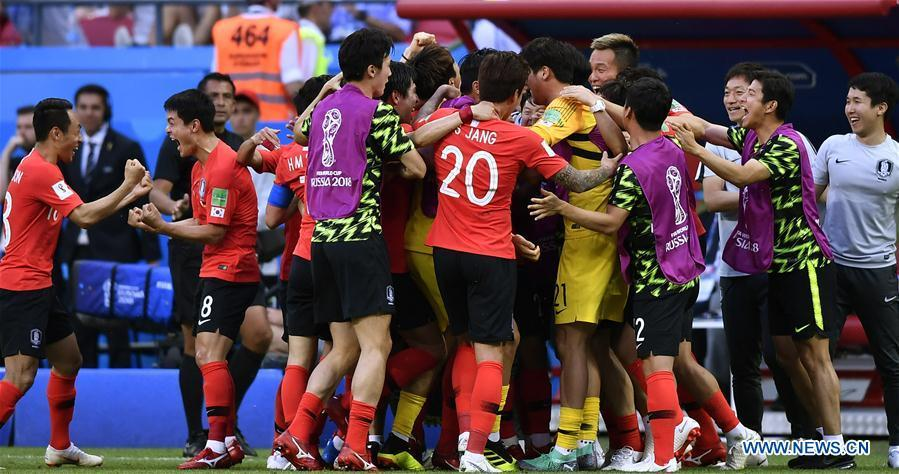 Players of South Korea celebrate scoring during the 2018 FIFA World Cup Group F match between Germany and South Korea in Kazan, Russia, June 27, 2018. South Korea won 2-0. (Xinhua/Chen Yichen)