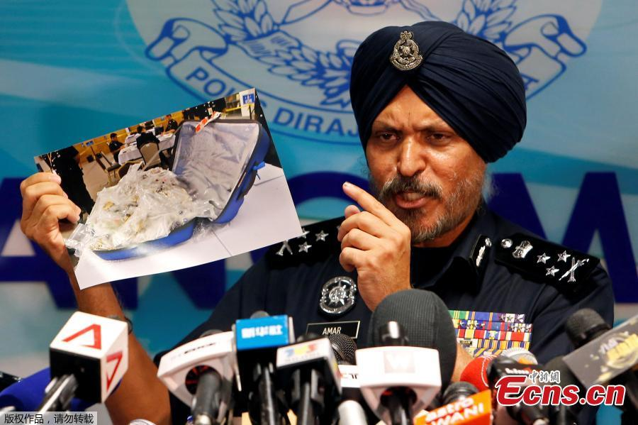 Amar Singh, head of Malaysia\'s Commercial Crime Investigation Department (CCID), displays photos of items from a raid on former Malaysian Prime Minister Najib Razak\'s premises during a news conference in Kuala Lumpur, Malaysia June 27, 2018.Malaysian police say the total value of cash, jewelry and hundreds of watches and handbags seized from properties linked to former Prime Minister Najib Razak in a money-laundering investigation amounted to $273 million. (Photo/Agencies)