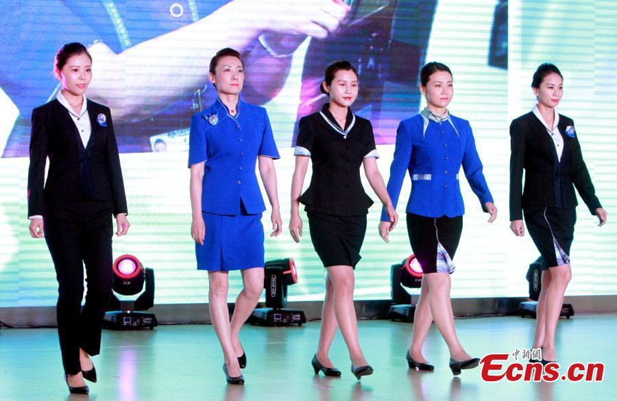 Staff members of the Tianjin Binhai International Airport show new uniforms at the airport, June 28, 2018. (Photo/China News Service)
