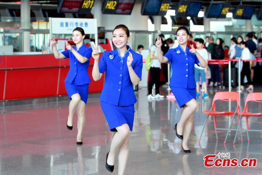 Staff members of the Tianjin Binhai International Airport stage a flash mob at the airport, June 28, 2018. (Photo/China News Service)
