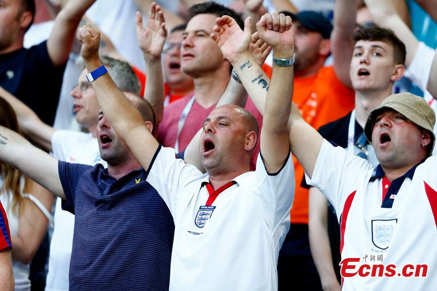 A fan reacts during the World Cup match between England and Belgium in Kaliningrad Stadium, Kaliningrad, Russia, June 28, 2018. Belgium remained unbeaten in Russia World Cup as they defeated England and will face Japan in the knockout stage. Belgium\'s Adnan Januzaj scored the only goal. (Photo: China News Service/Fu Tian)