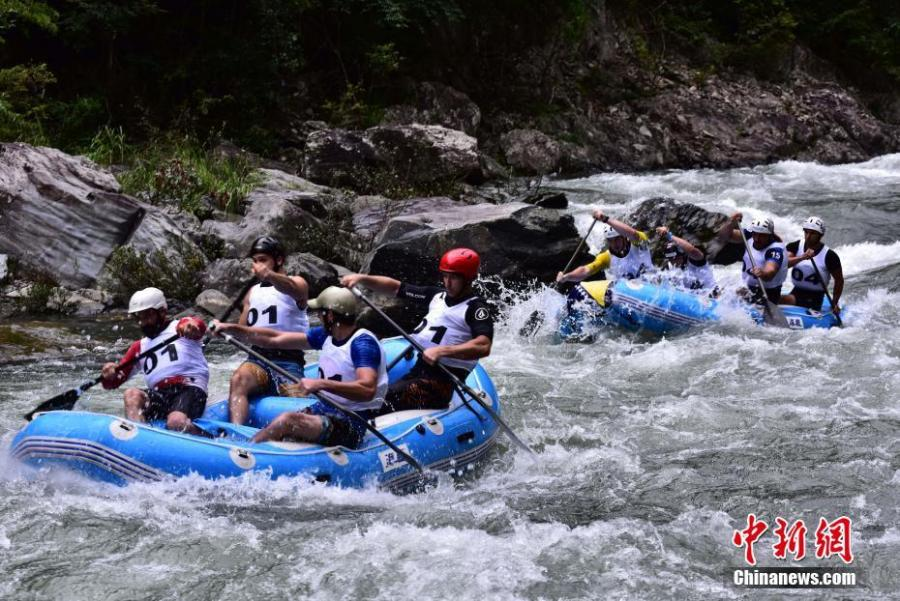 Participants ride down a river in an international rafting competition in Ziyuan County, Guilin City, South China's Guangxi Zhuang Autonomous Region, June 28, 2018. Twenty teams from 16 countries including Argentina, Brazil and Nepal took part in the contest. (Photo: China News Service/Tang Mengxia)