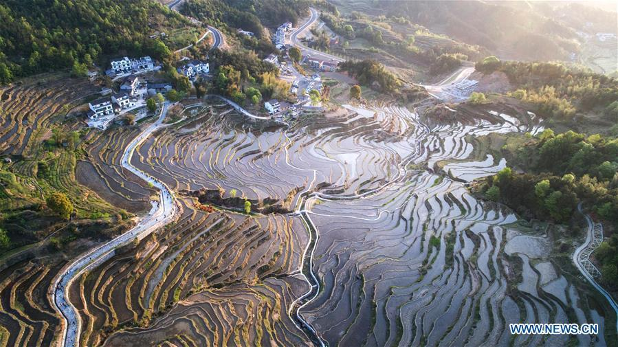 Aerial photo taken on April 10, 2018 shows the bird\'s-eye view of terraced fields on the Wuyun Mountain in Qichun County of central China\'s Hubei Province. Comprehensive progress has been made since the report delivered at the 18th National Congress of the Communist Party of China (CPC) in 2012 included ecological development as a major task in the country\'s overall plan and proposed building a \