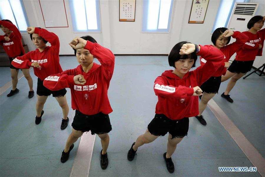 Chinese peacekeeper Yu Peijie (3rd L) dances with fellow soldiers in a gym at the camp of Chinese peacekeeping infantry batallion to South Sudan on April 30, 2018. Yu Peijie, 26-year-old, is the monitor of the female peacekeeper team of Chinese peacekeeping infantry batallion to South Sudan. She has a nickname called \