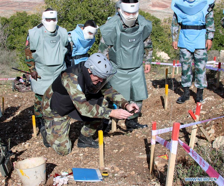 The photo taken on Dec. 15, 2017 shows Maj. Gen. Michael Beary, head of Mission and Force Commander of the United Nations Interim Force in Lebanon, taking photos of a removed mine at a minefield near the UN demarcated \