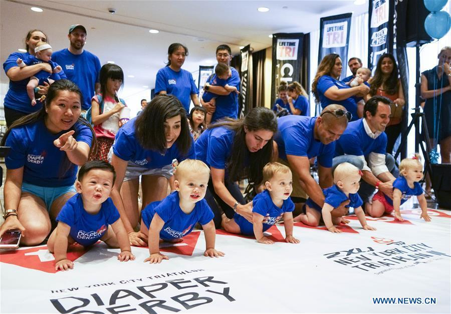 Babies participate in the Diaper Derby 2018 in New York, the United States, June 29, 2018. Diaper Derby 2018, a baby crawling contest, was held here on Friday. Around 30 babies competed to crawl across a 12-foot (3.66 meters) long mat. (Xinhua/Lin Bilin)