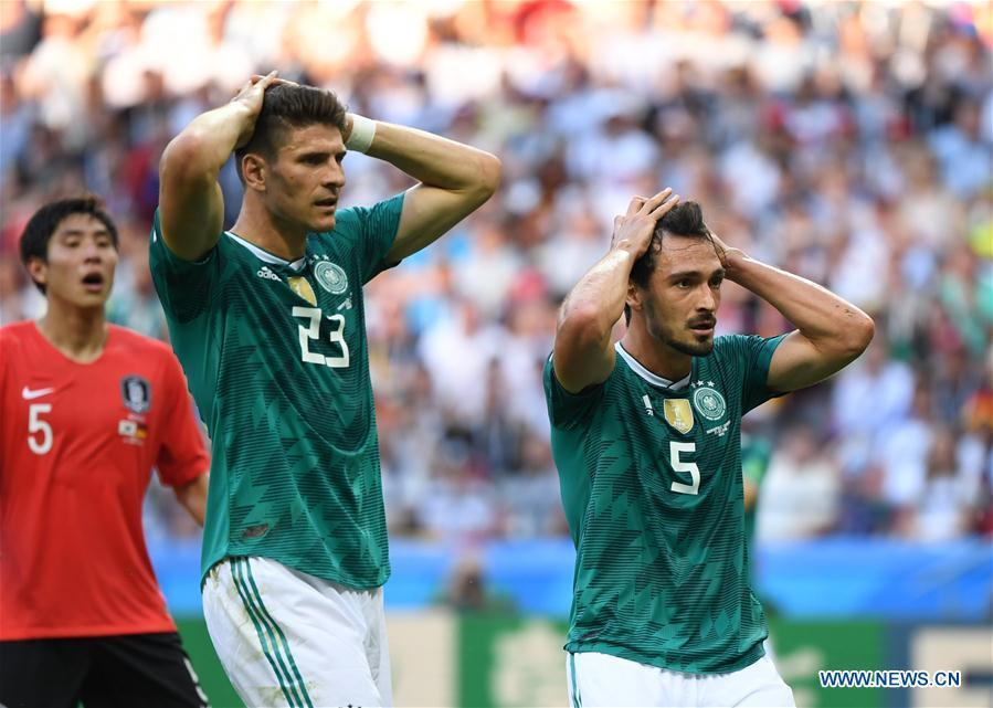 Mario Gomez (C) and Mats Hummels of Germany react during the 2018 FIFA World Cup Group F match between Germany and South Korea in Kazan, Russia, June 27, 2018. (Xinhua/Li Ga)