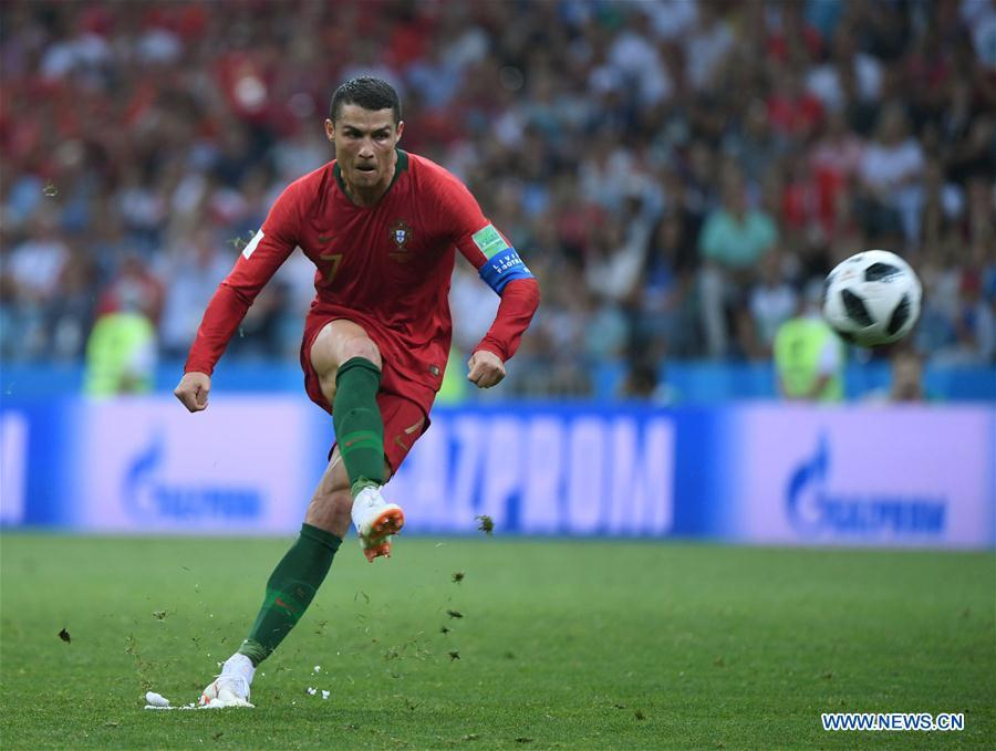 Portugal\'s Cristiano Ronaldo scores a free kick during a group B match between Portugal and Spain at the 2018 FIFA World Cup in Sochi, Russia, June 15, 2018. The match ended in a 3-3 draw. (Xinhua/Li Ga)