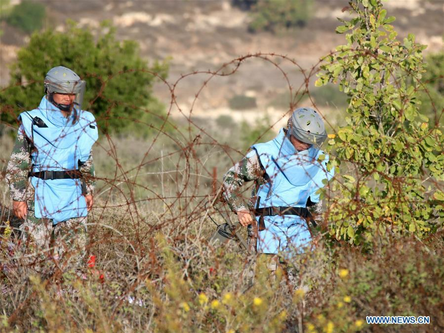 The photo taken on Nov. 8, 2017 shows Chinese peacekeepers working at a minefield near the UN demarcated \