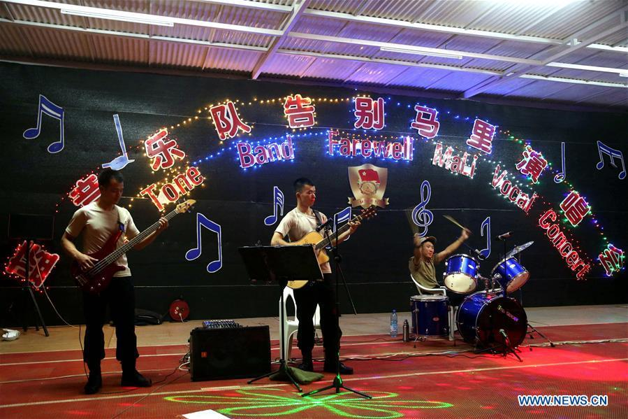 Blue Tone band of Chinese peacekeepers perform during their farewell concert at the Chinese camp of the UN Multidimensional Integrated Stabilization Mission in Mali, May 12, 2018. In late 2013, China, for the first time, dispatched a security force of 170 soldiers to the UN Multidimensional Integrated Stabilization Mission in Mali (MINUSMA). Among the fifth batch of Chinese peacekeepers of MUNISMA, six soldiers established Blue Tone band in their spare time. On May 12, 2018, the Blue Tone band held a farewell concert before its members returned to China. This year marks the 70th anniversary of UN peacekeeping. China began its participations in the UN peacekeeping operations in 1990. Today, China has some 2,500 peacekeepers and plays an important role in promoting and maintaining world peace. (Xinhua/Han Lijian)