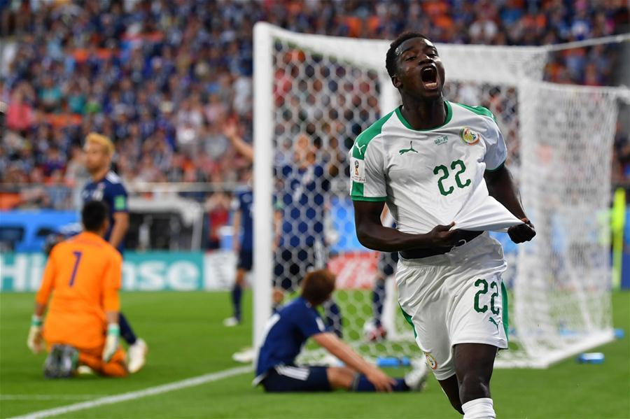 Moussa Wague (R front) of Senegal celebrates scoring during the 2018 FIFA World Cup Group H match between Japan and Senegal in Yekaterinburg, Russia, June 24, 2018. (Xinhua/Chen Cheng)